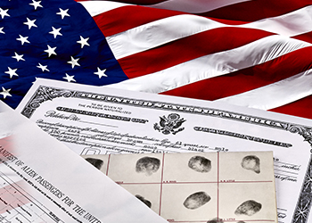 Immigration documents on an American flag