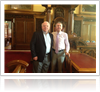 John Foley and Mairtin O Muilleoir standing side by side smiling