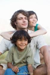 Smiling man, woman, and child