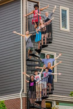 Family photo on a spiral staircase