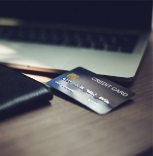 Credit Card and Wallet by a laptop, credit card in focus