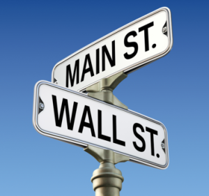 Street sign of Main Street and Wall Street