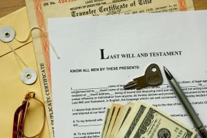 Last Will and Testament Document with keys, a pen, and money on top of it