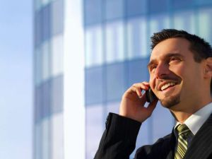 young businessman on phone outside building