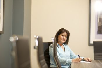 Sue Palmer working in a conference room