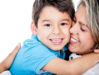 Happy mother holding happy child