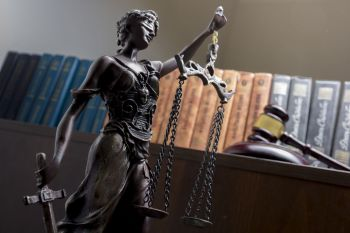 Scales of Justice in front of law books
