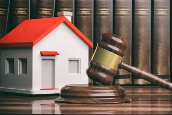 Gavel in front of a home