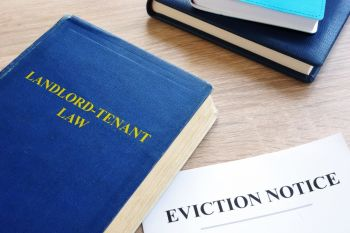 Landlord-Tenant Law book next to an eviction notice
