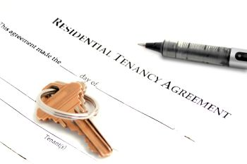 Residential Tenancy Agreement with keys on it