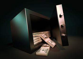 Open safe full of cash