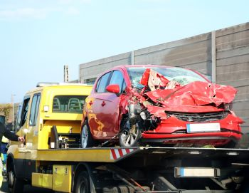 wrecked car on a trailer