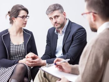 Concerned Couple Listening to a Mediator