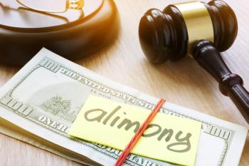 Stack of money labeled 'alimony' next to gavel.