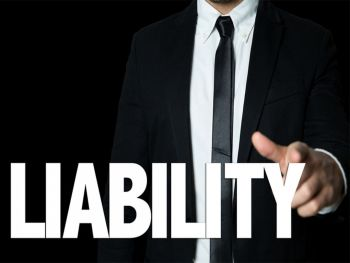 """Man in a suit pointing at the words """"Liability"""""""