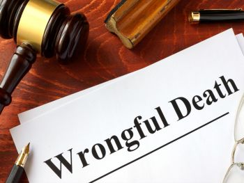 Wrongful Death documemt on a desk with a pen and gavel