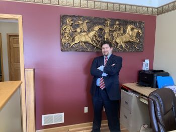 Attorney Ryan A. Slep standing in his office