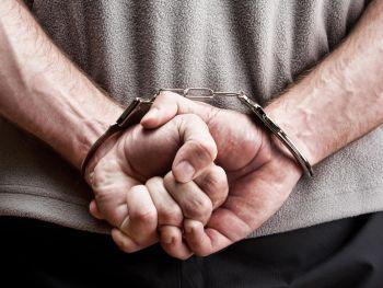 Man handcuffed behind his back