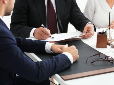 Three Attorneys Looking Over Paperwork