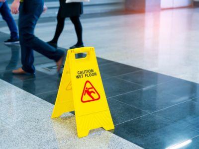 Cation wet floor sign on tile