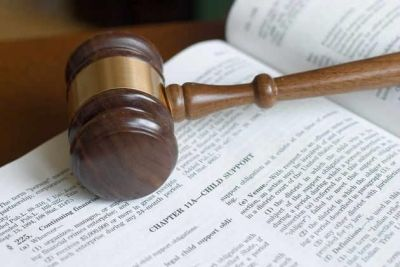 Gavel resting on top of an open book