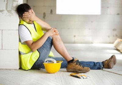 Consruction worker with hand on bloody knee