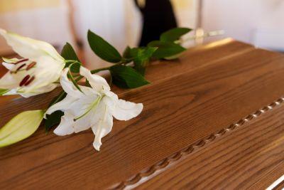 Flowers on top of casket