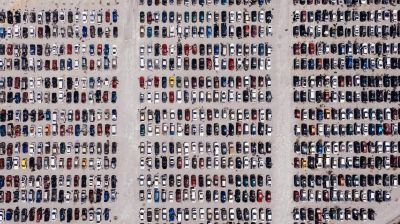 View from above of cars parked in a large lot