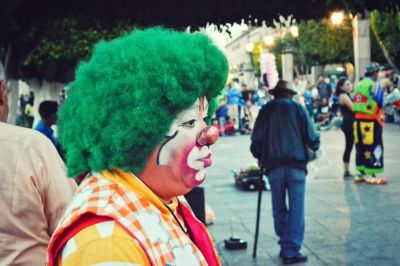 Clown with sad expression looking forward