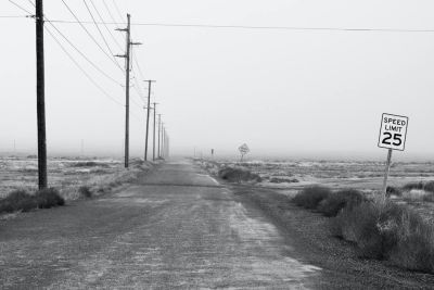 Empty dead road with a 25 mph speed limit