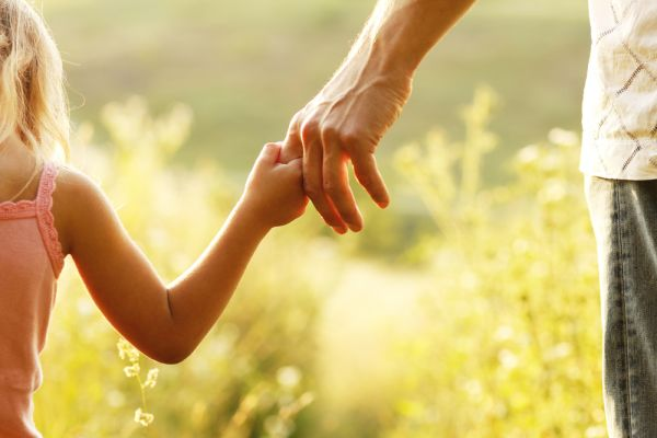 Father holding his daughter's hand