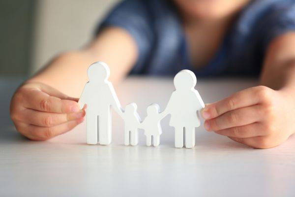 Childing holding a small family