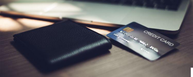 Credit Card & Wallet next to laptop