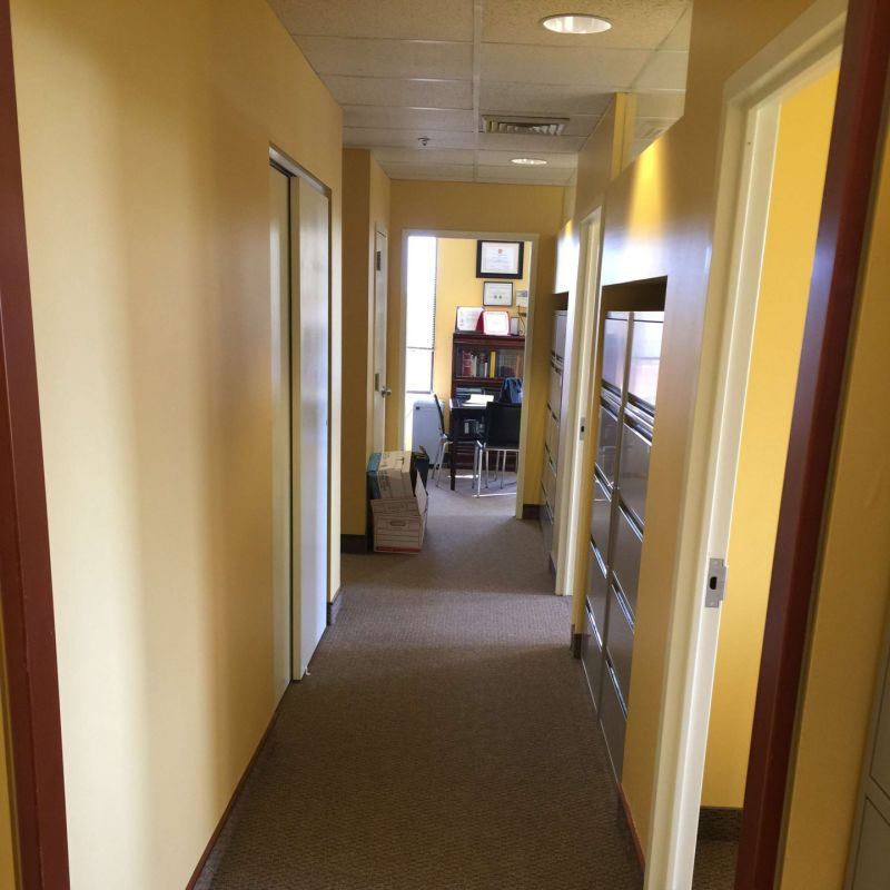 Inside of a hallway and an office