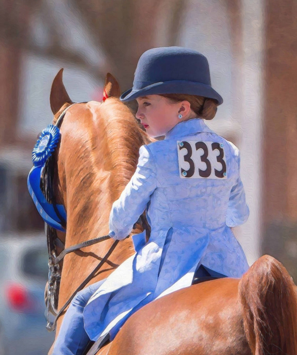 Equestrian event with girl rider