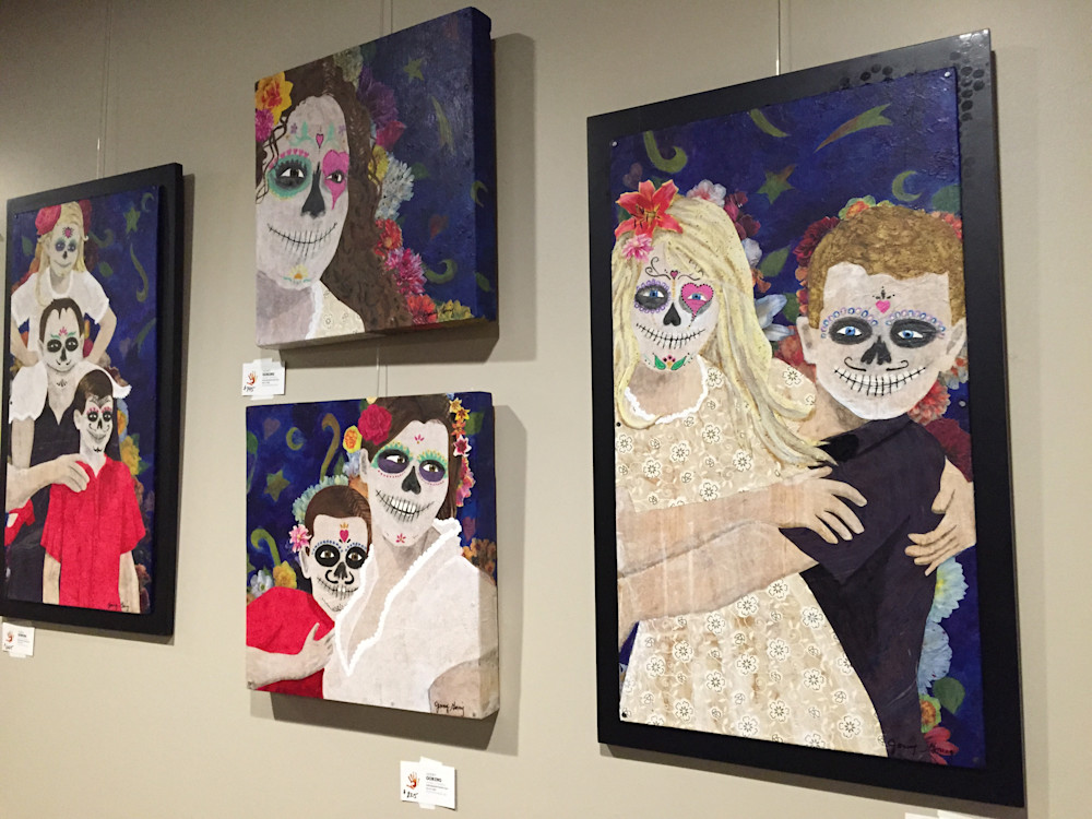 Four Mixed Media artworks hang on the wall. The theme is Dia de Los Muertos