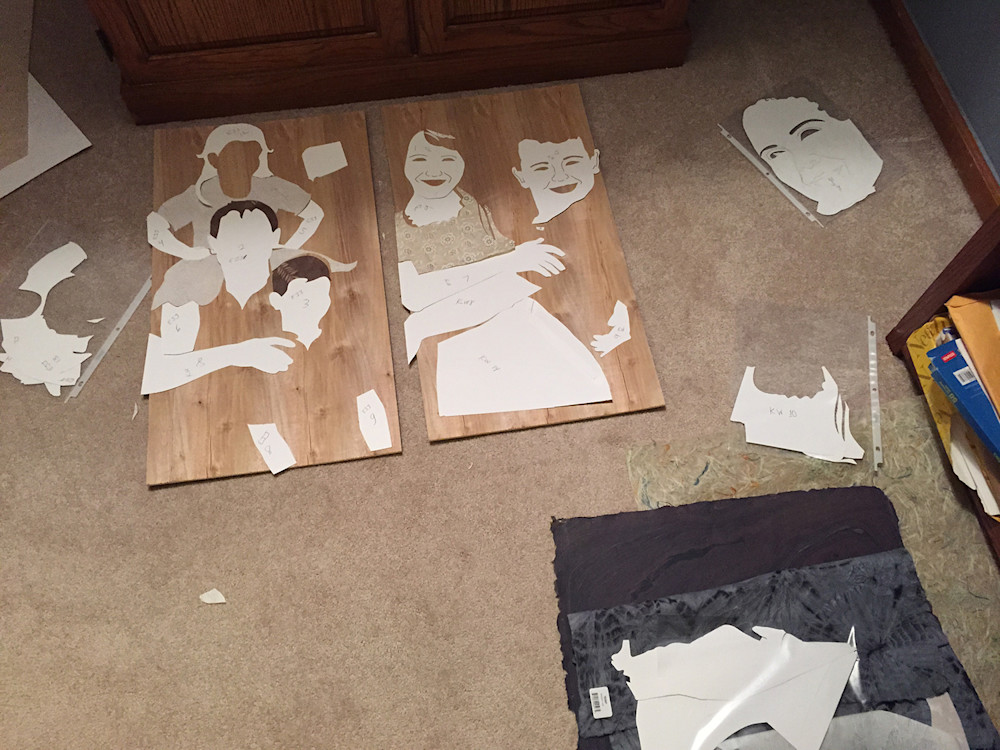 (Pattern pieces are arranged on wood panels to determine placement)
