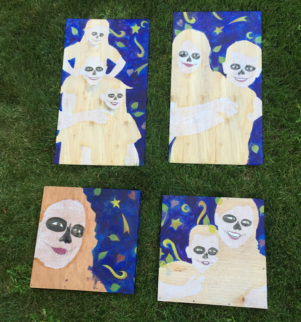 All four pieces have complete backgrounds, white tissue paper skin, and dark eye sockets.