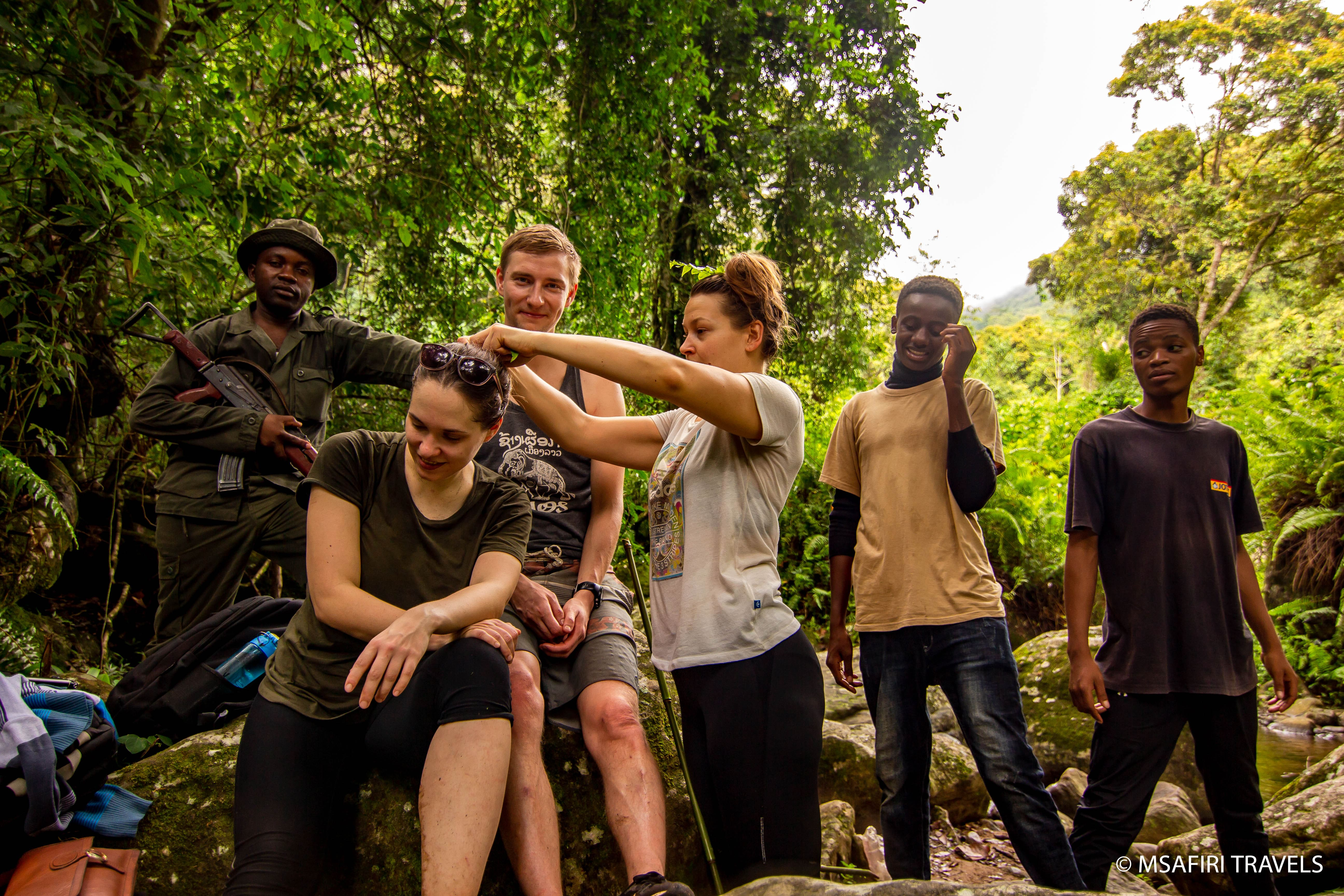 tourist hiking at udzungwa national park group safari