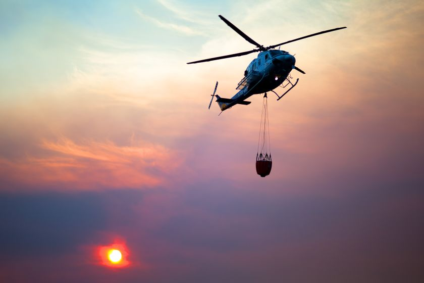 Helicopter putting out a fire