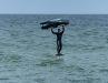 """3. Sobald du Schub durch die Welle bekommst, ziehe den Wing in einen neutrale Position über den Kopf (""""off"""")"""