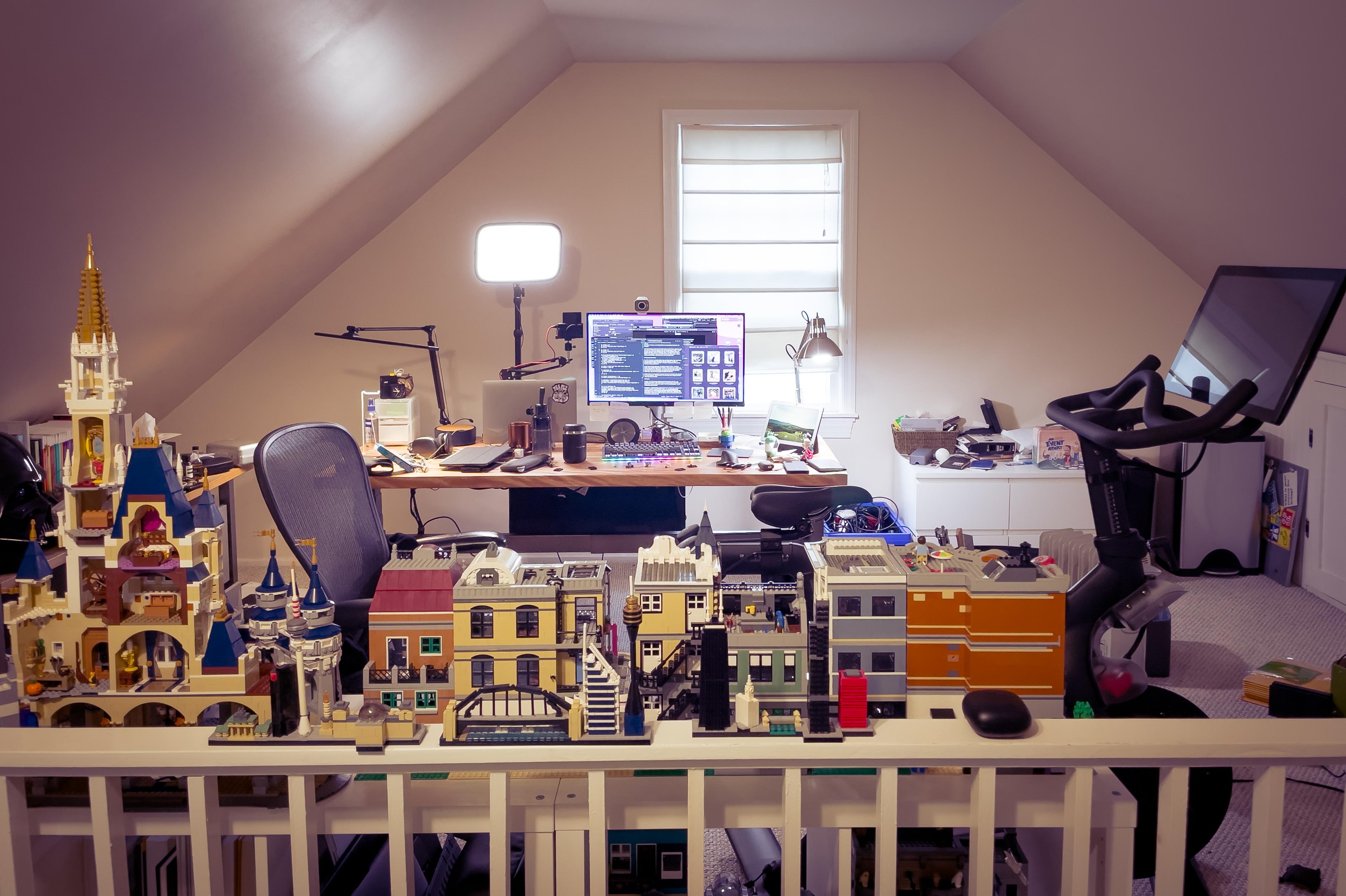 Desk, Peloton bike, and Lego sets