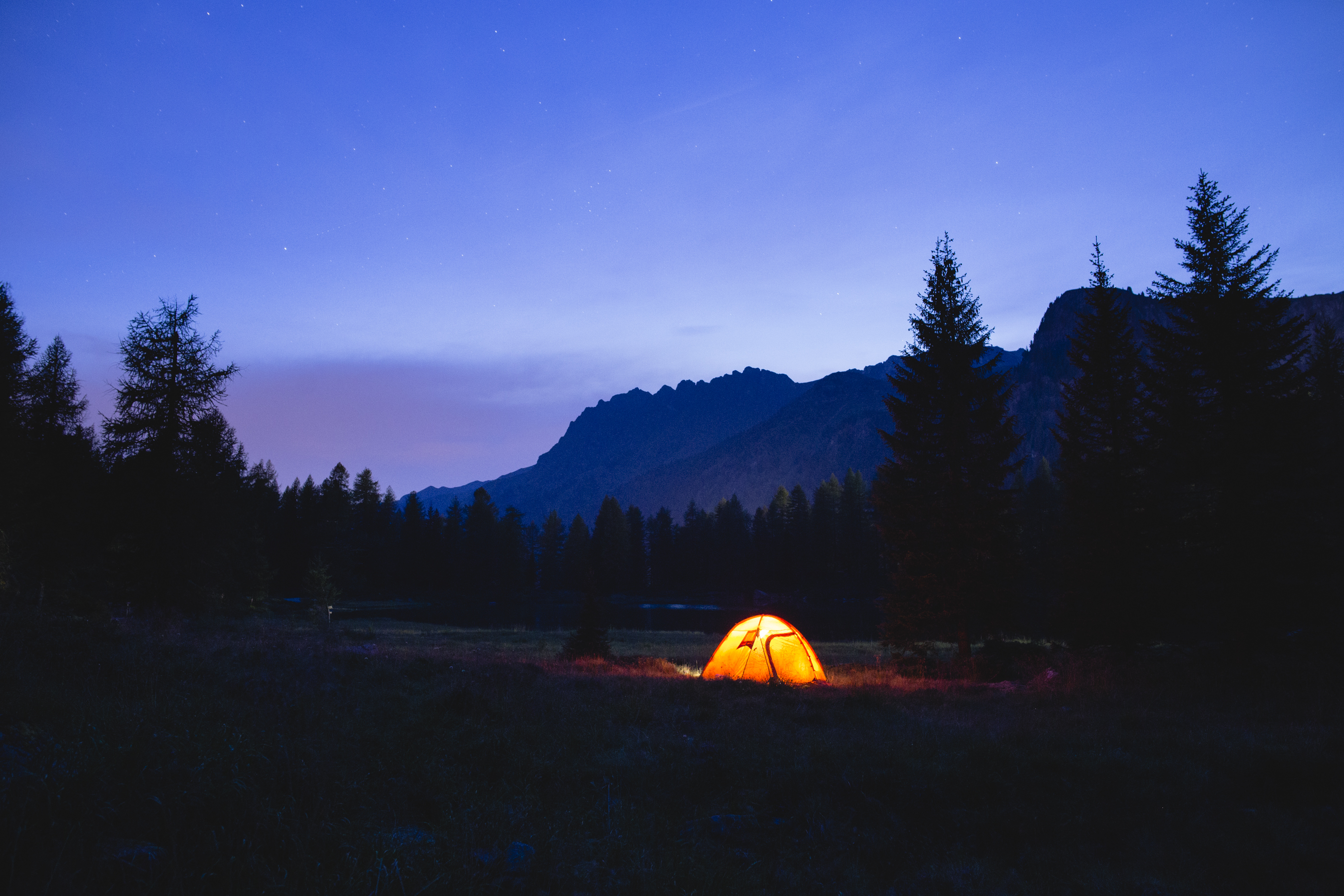 Night falls over a base camp