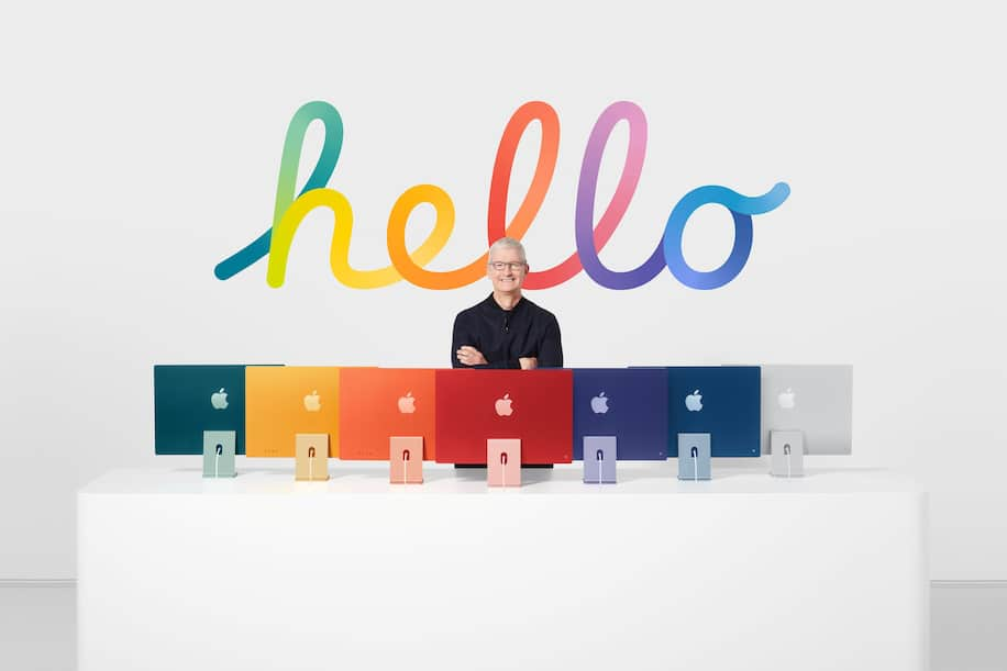 Apple CEO Tim Cook with many colorful iMac computers