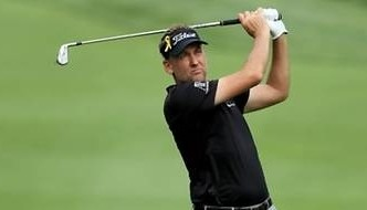 Poulter leads Bridgestone with 62, Woods four back