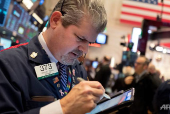 Dow hits 25,000 points for first time on US hiring data