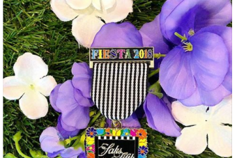 Only people who spend $500 at Saks in San Antonio will get this Fiesta medal