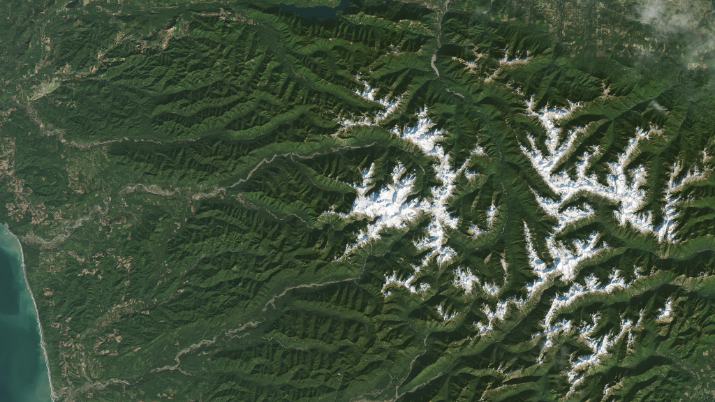 From Sandy Shores to Rugged Peaks by NASA