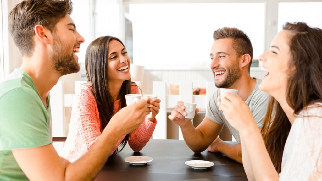 friends happily drinking coffee together