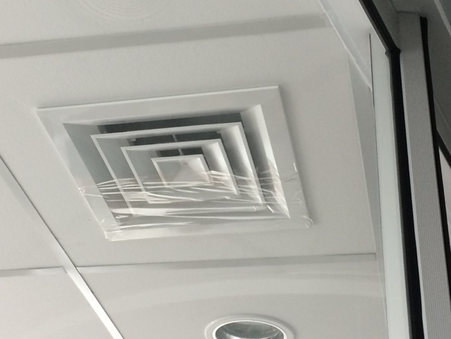 An airconditioning vent is mostly covered with tap in order to obstruct air flow